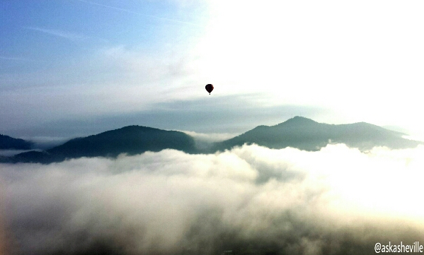hot air balloon mountains sky