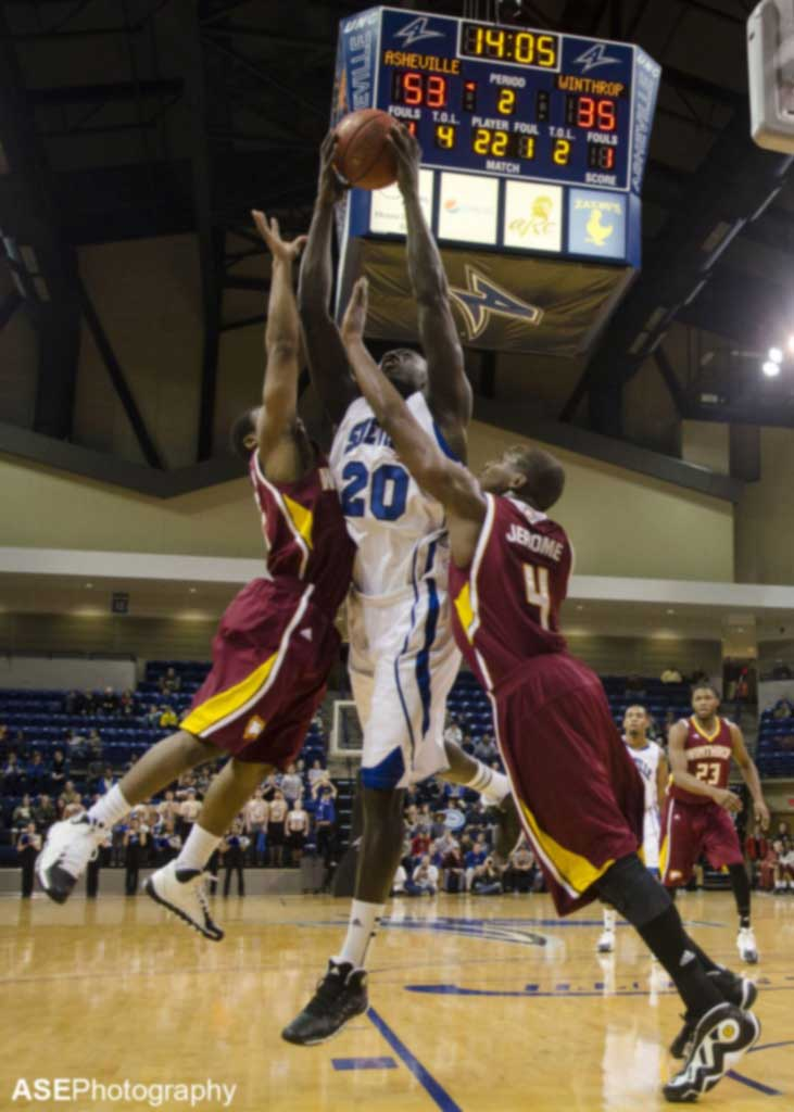 Chudier Pal goes up for a rebound against Winthrop